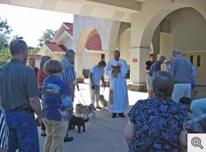 "Deacon John Froning presides over the Sacred Heart of Jesus ""blessing of the pets"""