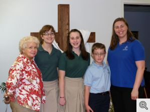 The Ladies of Sacred Heart of Jesus funded a $1,200 scholarship to St. John's Catholic School in Hot Springs as part of their annual disbursement of charitable fund raising proceeds for the year.  Pictured are Sheila Harrison, 2010-2011 president of the Ladies of Sacred Heart, St. John's students Megan Shaffer, Lexi Myers, and Dayton Myers, and St. John's Principal, Elizabeth Shackelford.  The scholarship is intended to help defray tuition costs for students from lower income households.