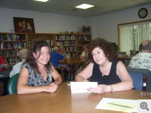 Carol Barrett, Ladies of Sacred Heart board member, meets with Amanda Maness, site director at McCauley Center to discuss volunteer opportunities with the Meals on Wheels program.  Ladies of Sacred Heart donated $500 to help with the cost of meals delivered in Garland County.