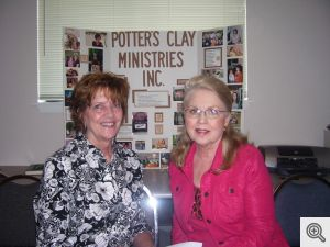 Millie Connelly visits with Elizabeth Brakebill, executive director of The Potter's Clay Ministries.  Mrs. Connelly presented Ms. Brakebill with a check for $500 from Ladies of Sacred Heart.  The money will be used toward utility bills in the three sheltes provided for women and children in crisis.